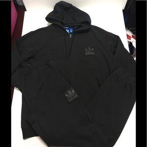 Black on black Adidas zip up hooded sweatsuit